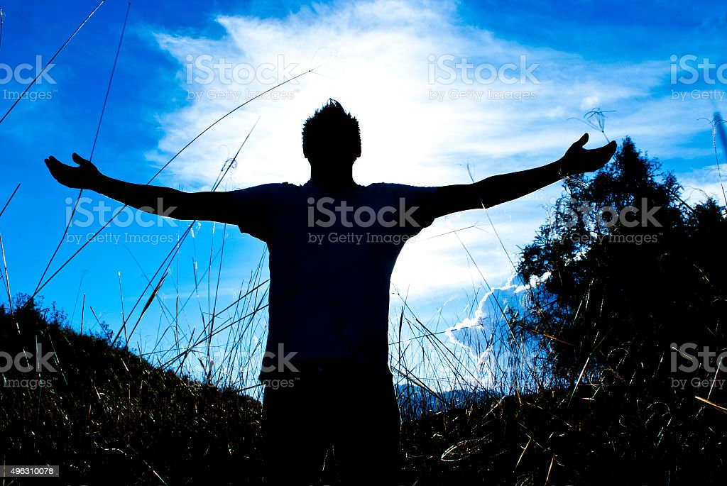 Man praying, meditating in harmony and peace at sunset. Religion,...