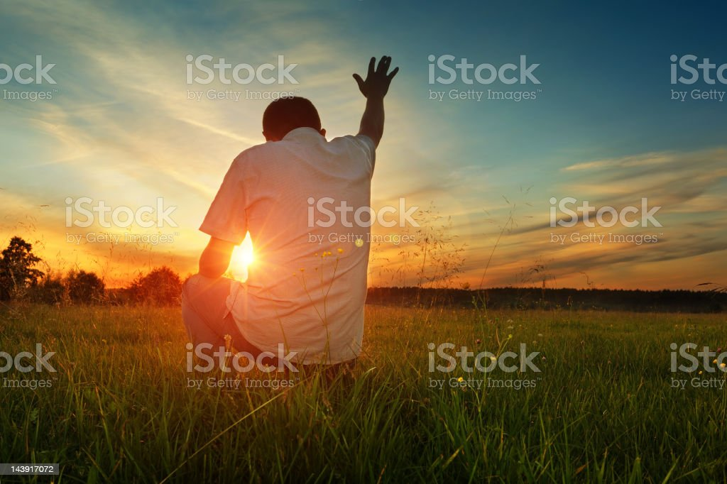 Man prays to God stock photo