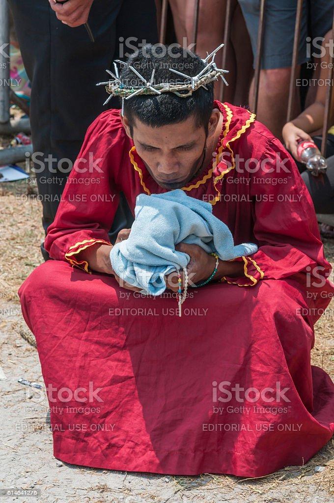 Man prepares for crucifixion stock photo