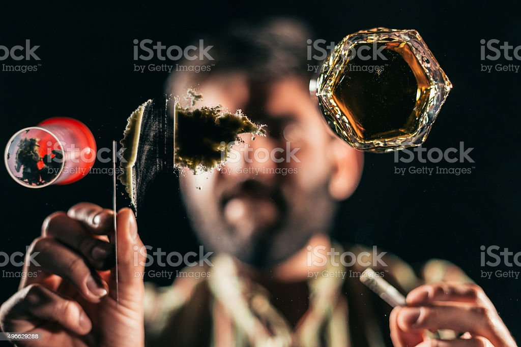 Man preparing a line of cocaine stock photo