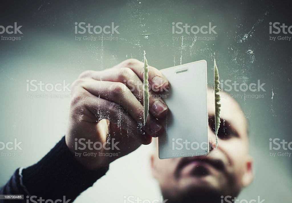 Man preparing cocaine stock photo