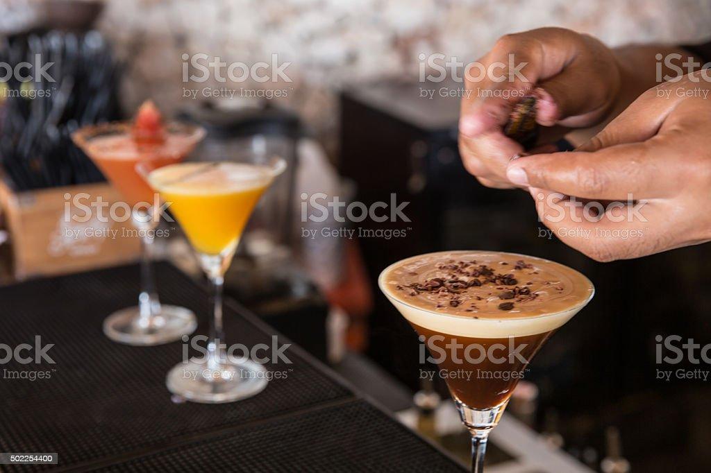 Man preparing espresso martini stock photo