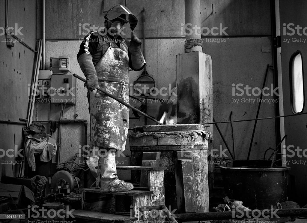 Man preparing for bronze casting. stock photo