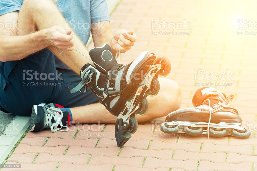 Man preparing for roller blading, stock photo