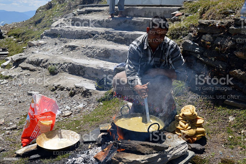 Man preparing halwa puri stock photo