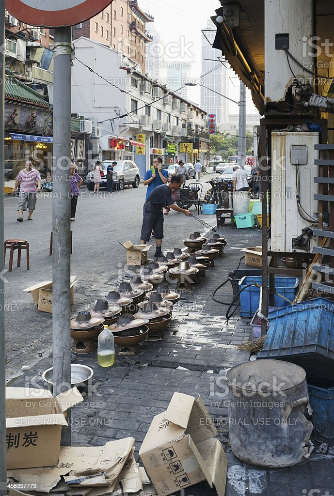 Man preparing hot pots of Shanghai street restaurant stock photo