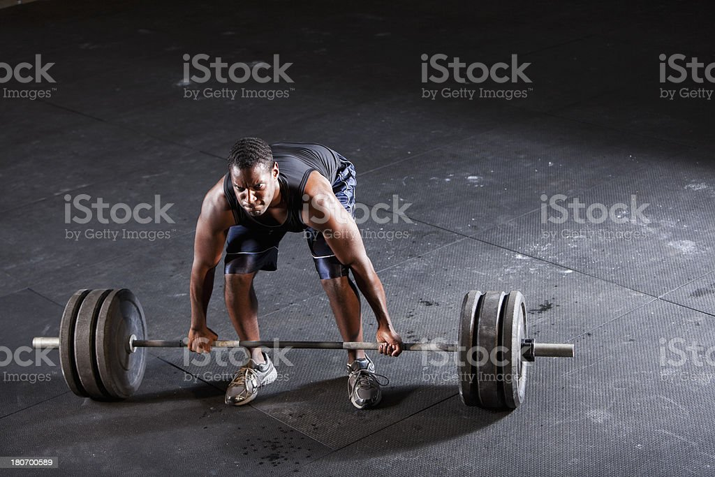 Man preparing to do deadlift stock photo