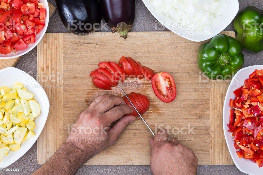 Man preparing vegetables in the kitchen stock photo