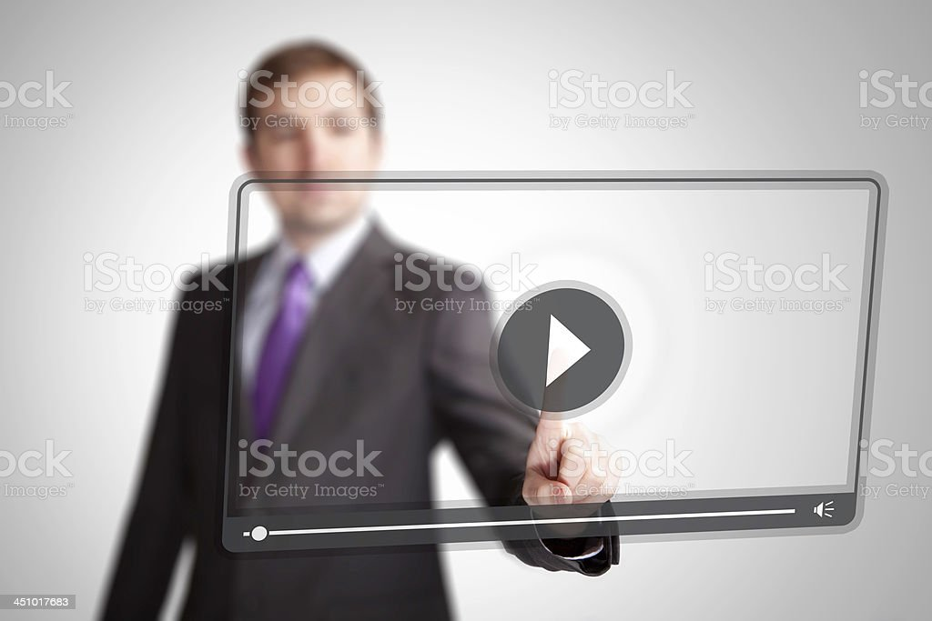 Man press video play button stock photo