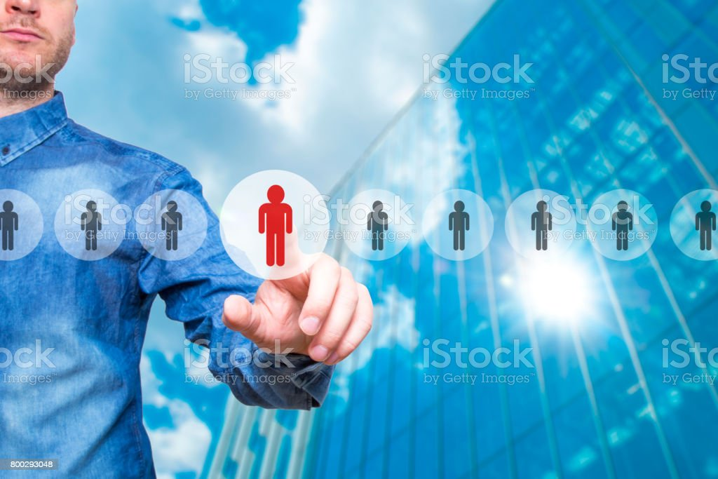 Man pressing button on virtual screens. Business, technology, internet, networking and recruitment concept - Isolated on grey background. Stock Photo stock photo