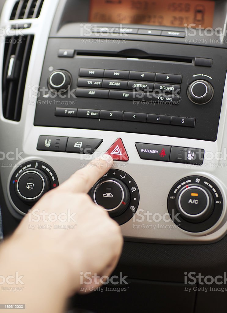 man pressing car hazard warning button royalty-free stock photo