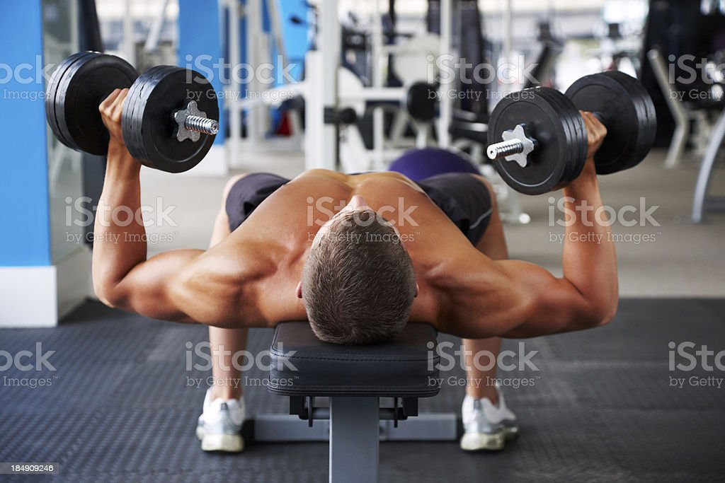Man Pressing Dumbbells royalty-free stock photo