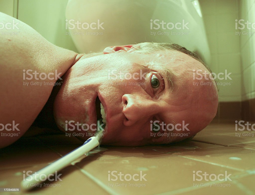 Man pretending to be dead from heart attack stock photo