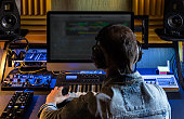 Man produce electronic music in studio