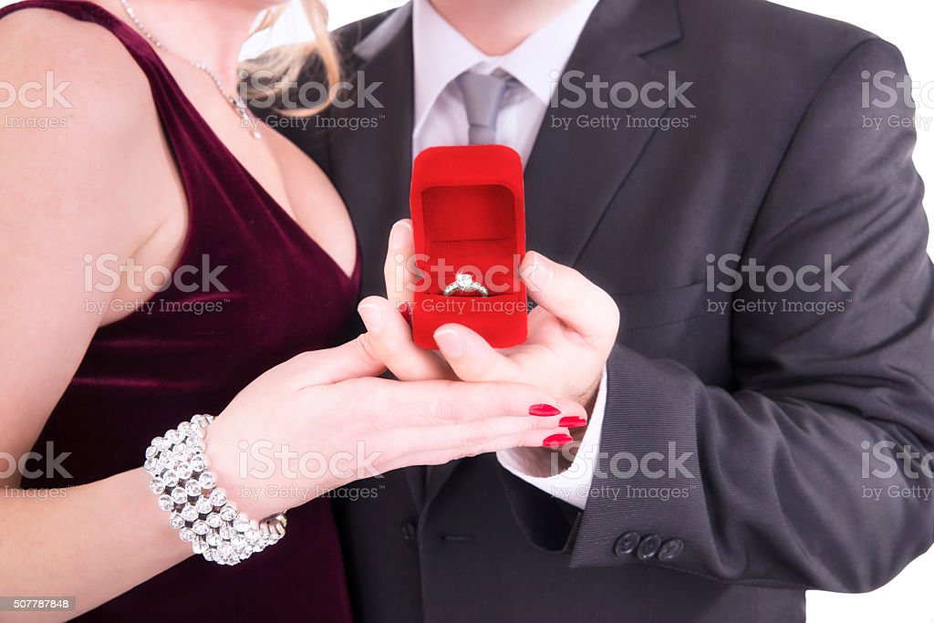 Man proposing engagement ring stock photo