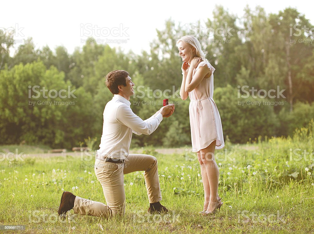 Man proposing ring woman, love, couple, date, wedding - concept stock photo