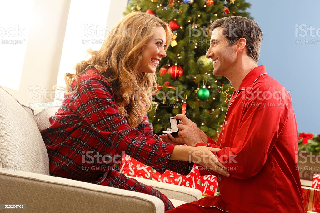 Man Proposing To His Girlfriend At Christmas stock photo