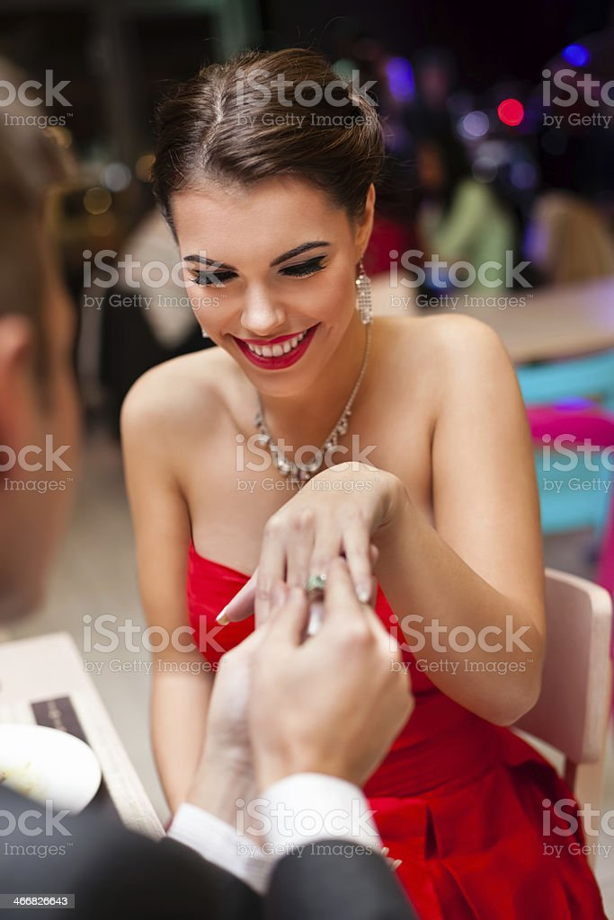 man proposing with an engagement ring to his love stock photo