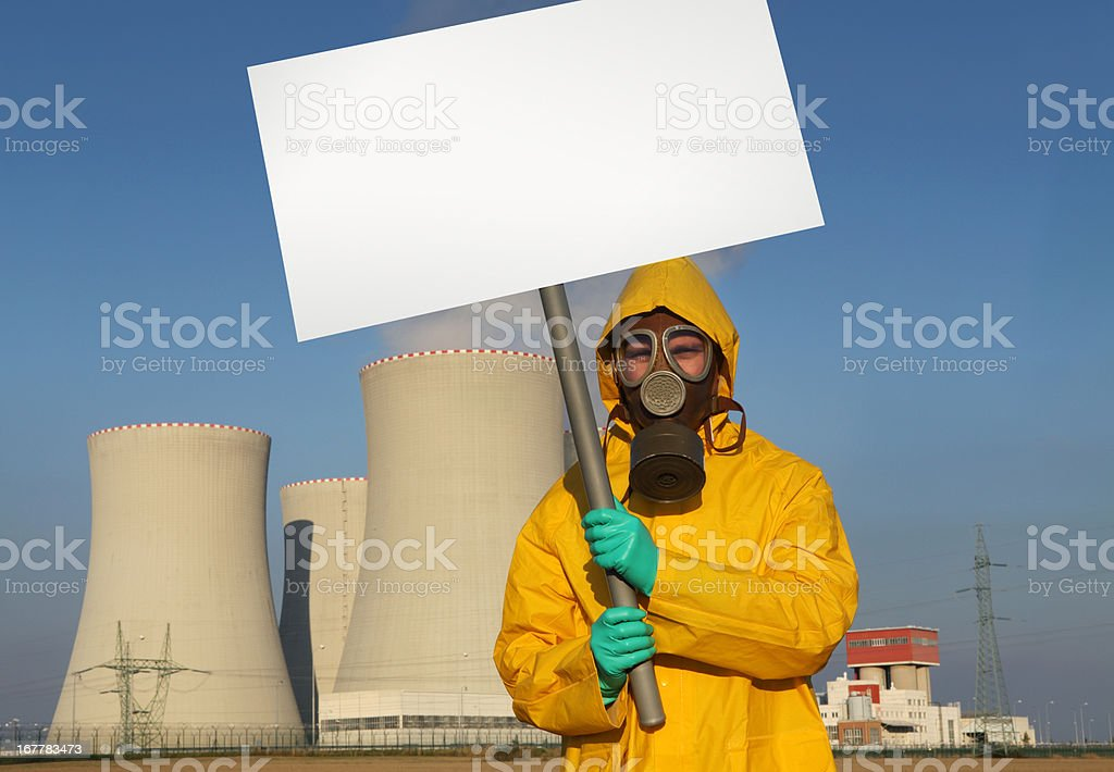 Man protesting in front of nuclear reactor stock photo