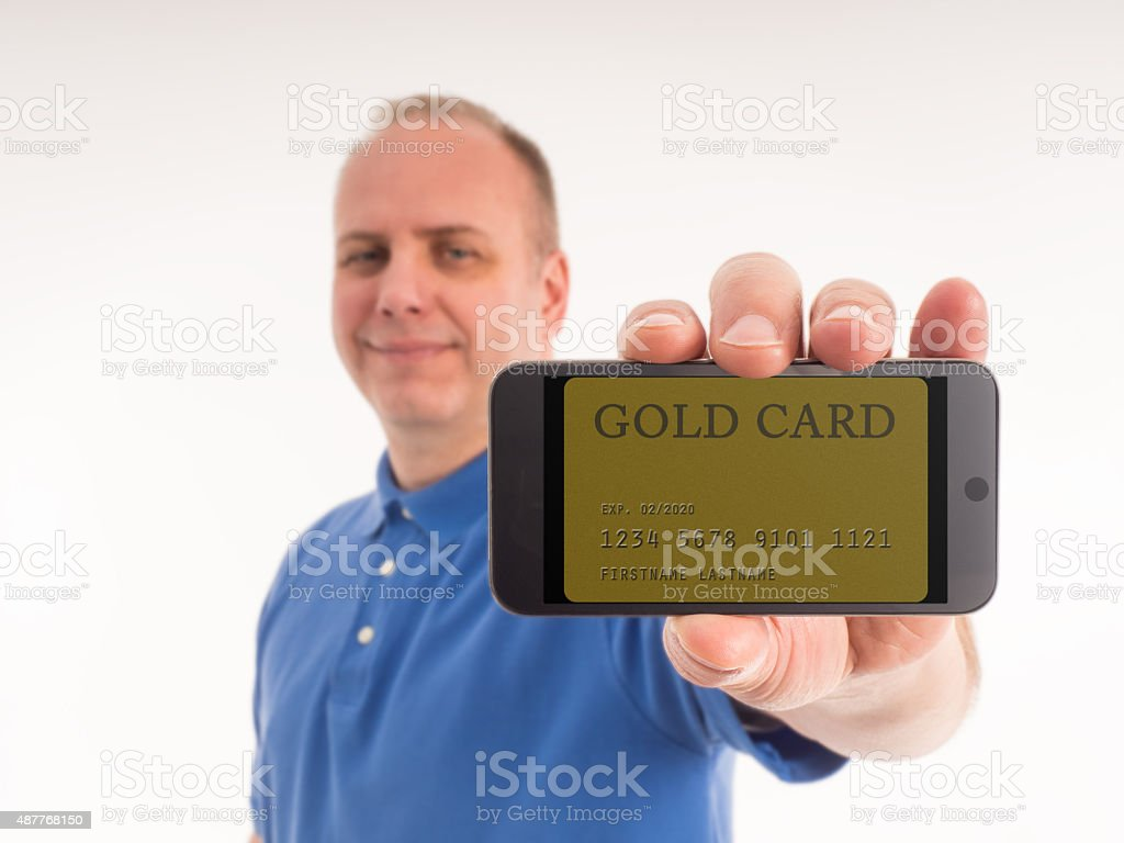 Man Proudly Displays the Gold Card on His Smart Phone stock photo