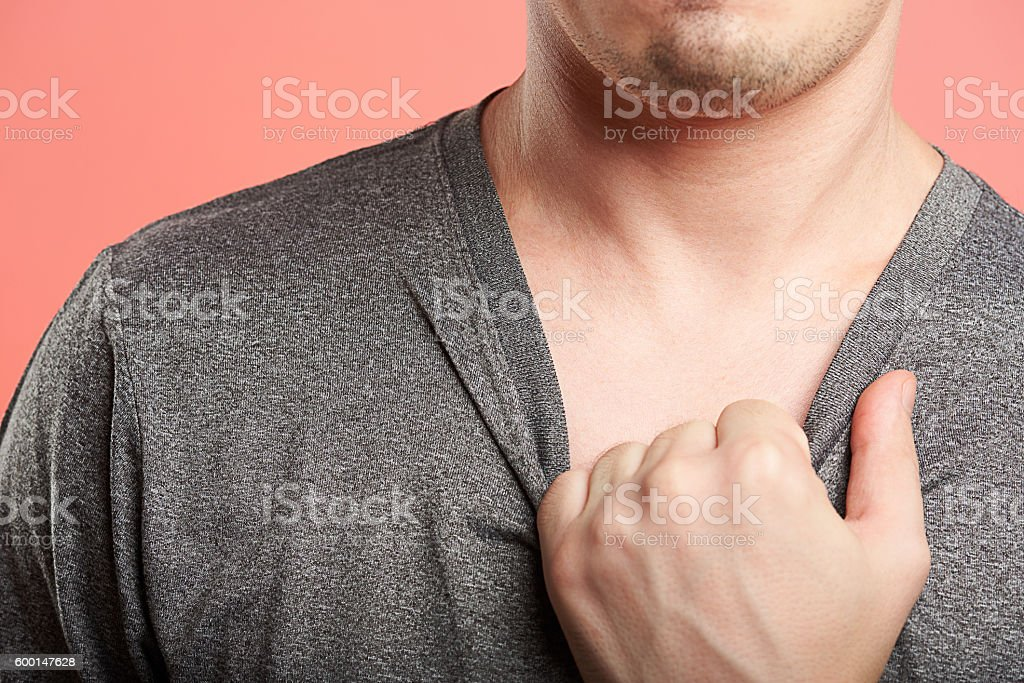 man pull gray shirt stock photo
