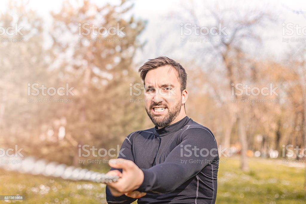 man pulling chain stock photo