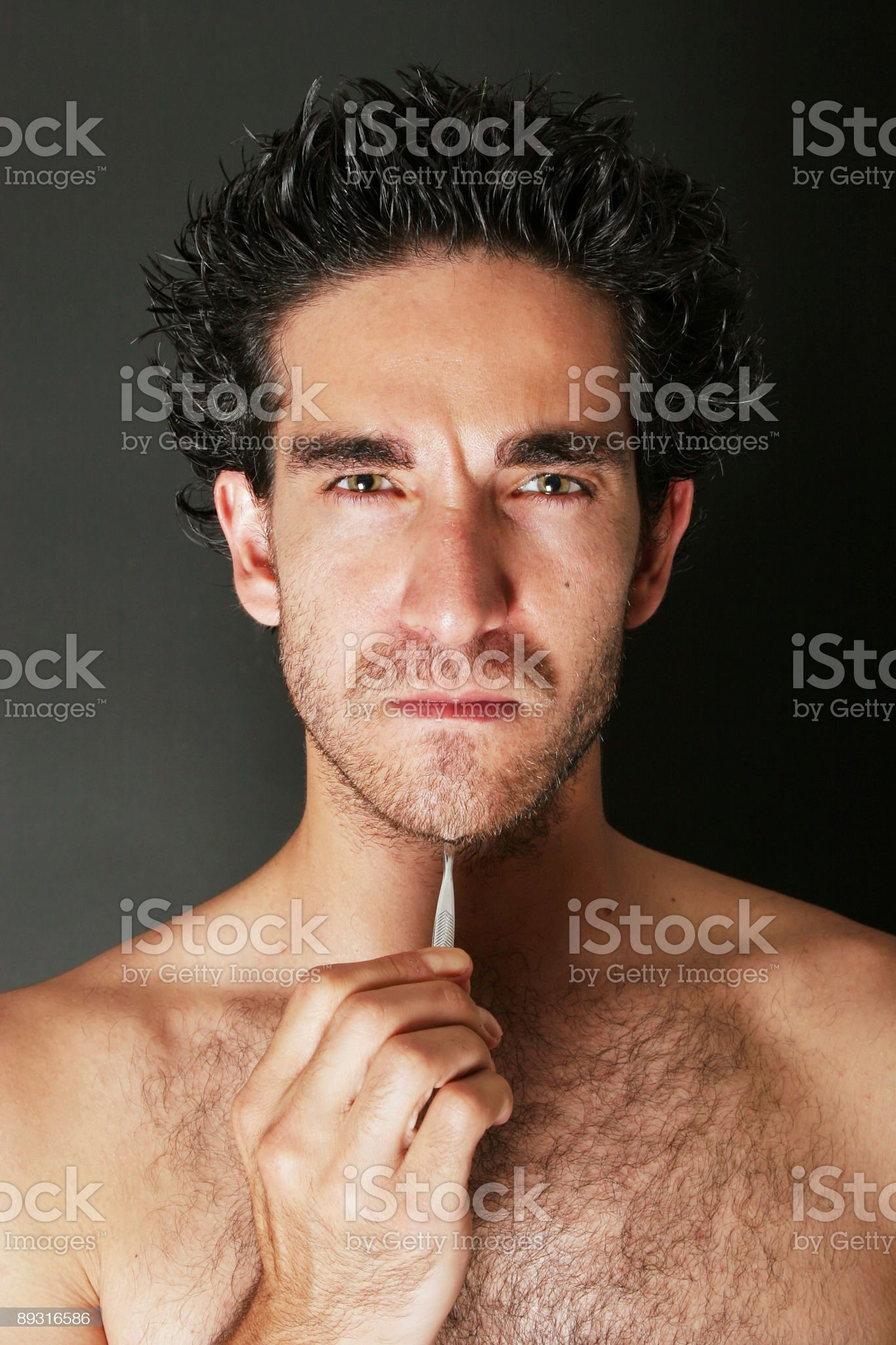 Man pulling his beard royalty-free stock photo