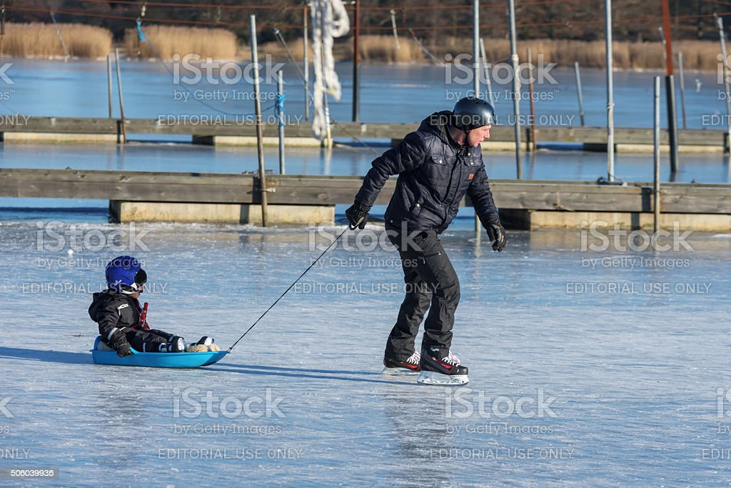 Man pulling kid stock photo