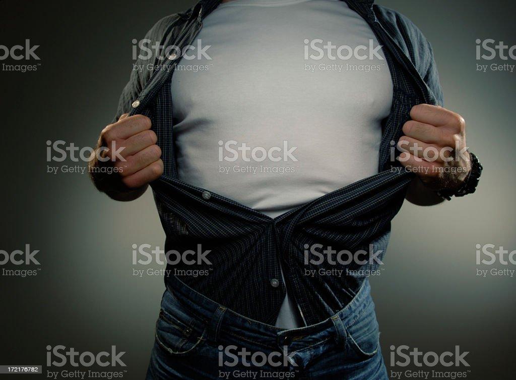 Man Pulling Open Shirt To Reveal White T Shirt stock photo