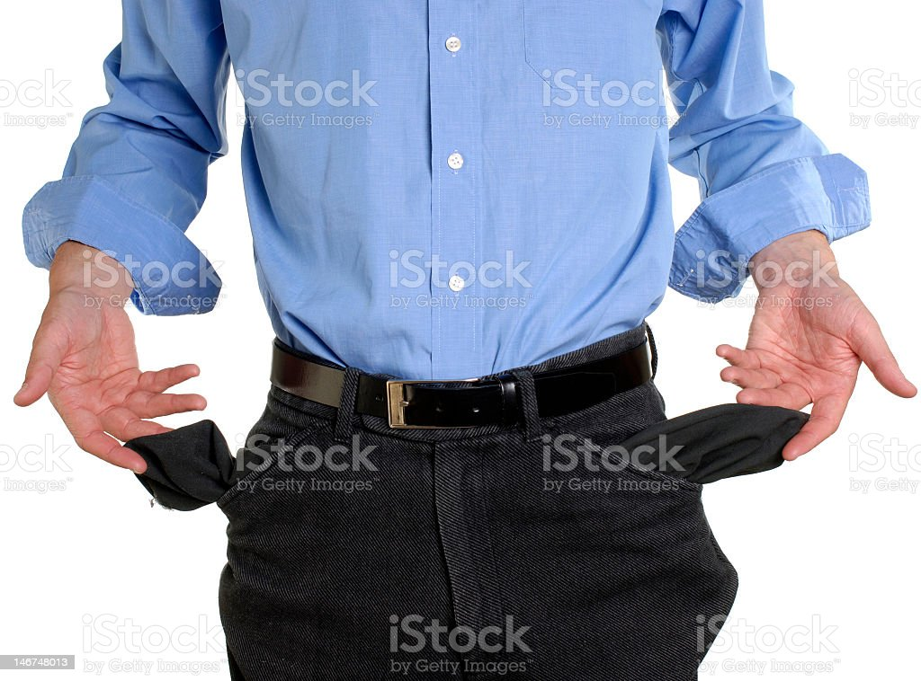 A man pulling out his pockets because he is broke  stock photo