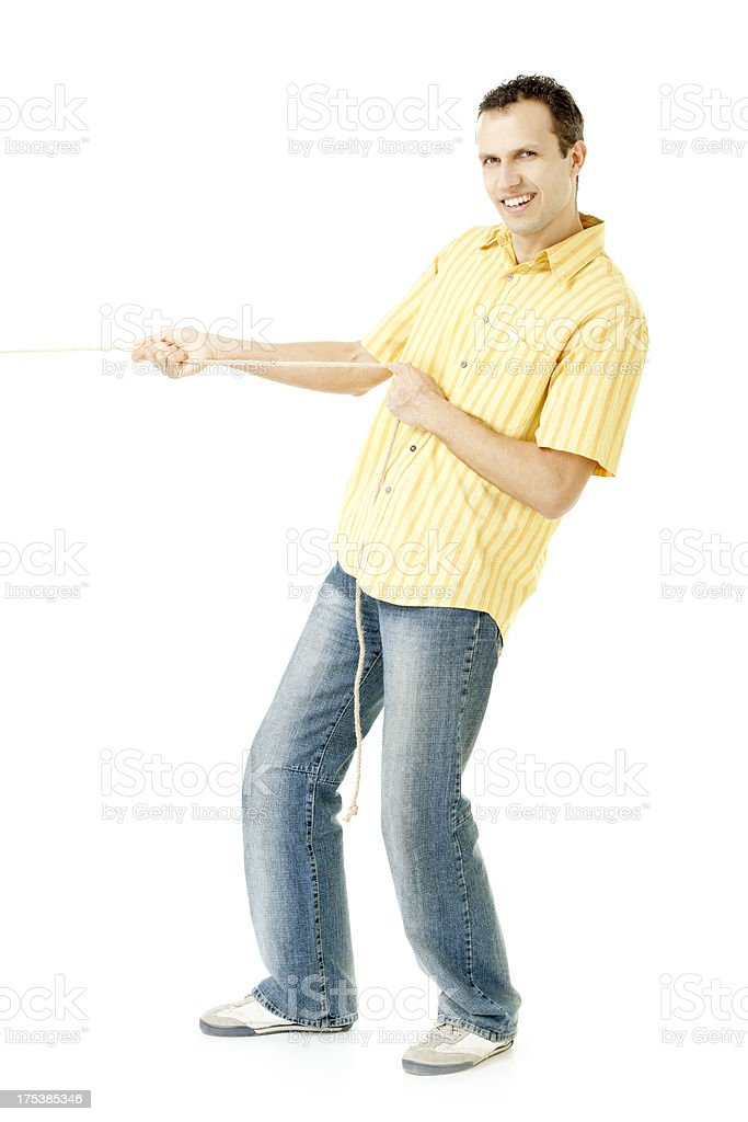 man pulling something stock photo