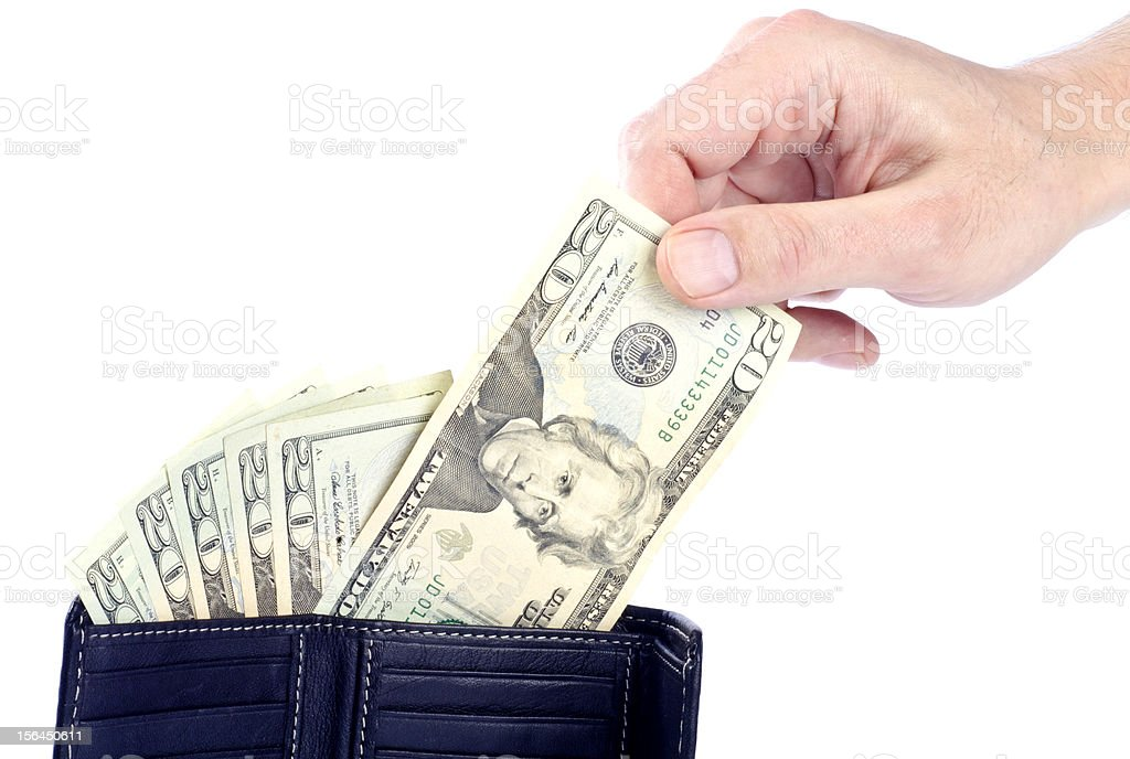 Man Pulling US Dollar Bill From a Wallet stock photo