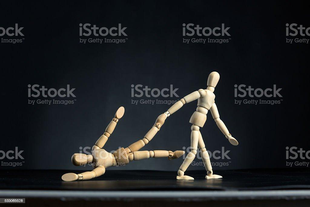 Man pulling woman by leg stock photo