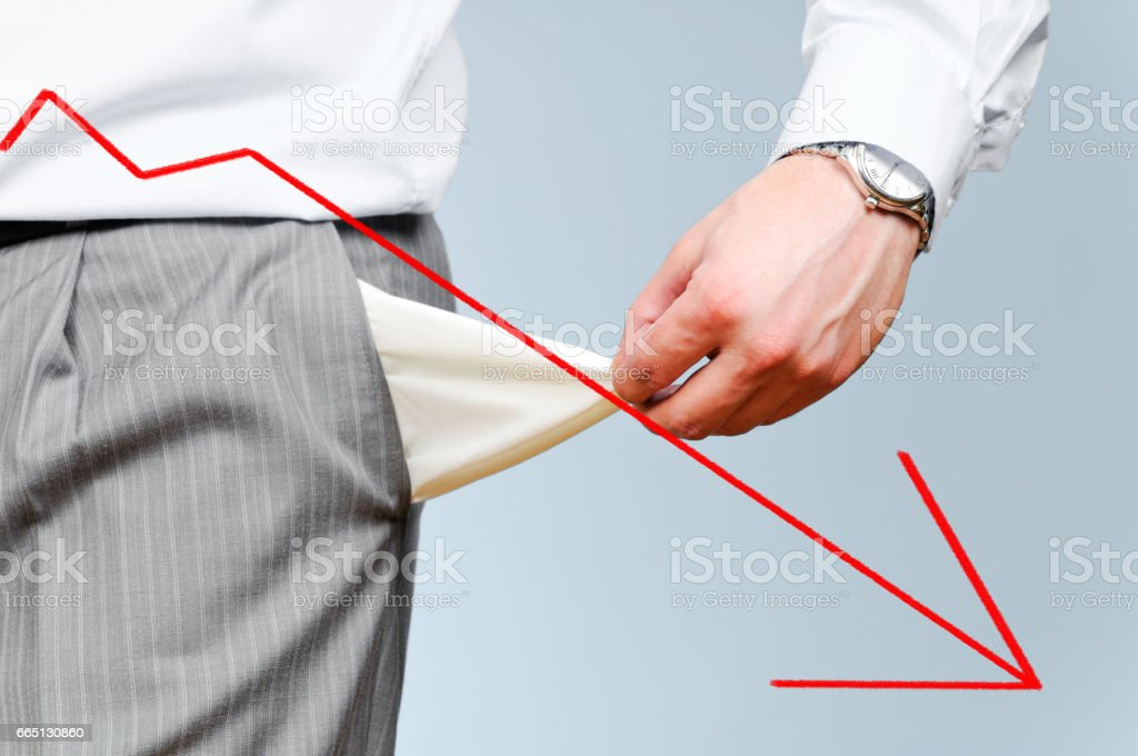 Man pulls out empty pockets stock photo