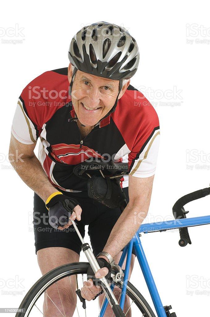 Man Pumping Bike Tire stock photo