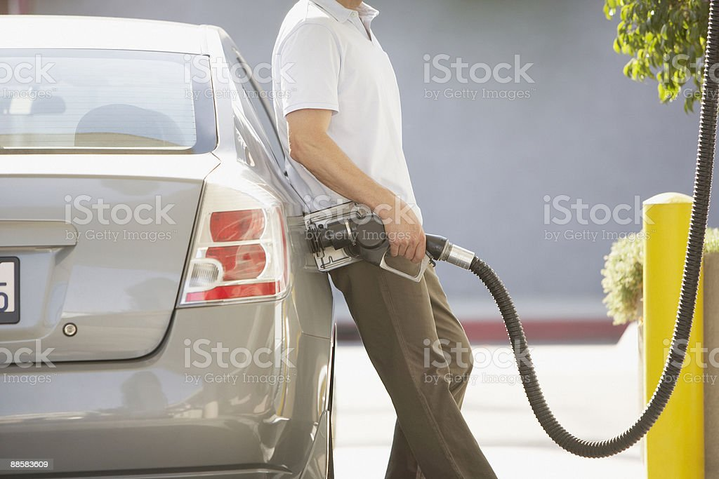 Man pumping gas stock photo