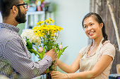 Man Purchasing Flowers at a Boutique