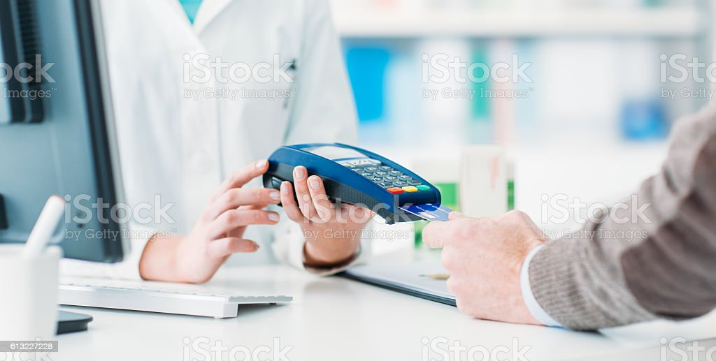 Man purchasing products in the pharmacy stock photo
