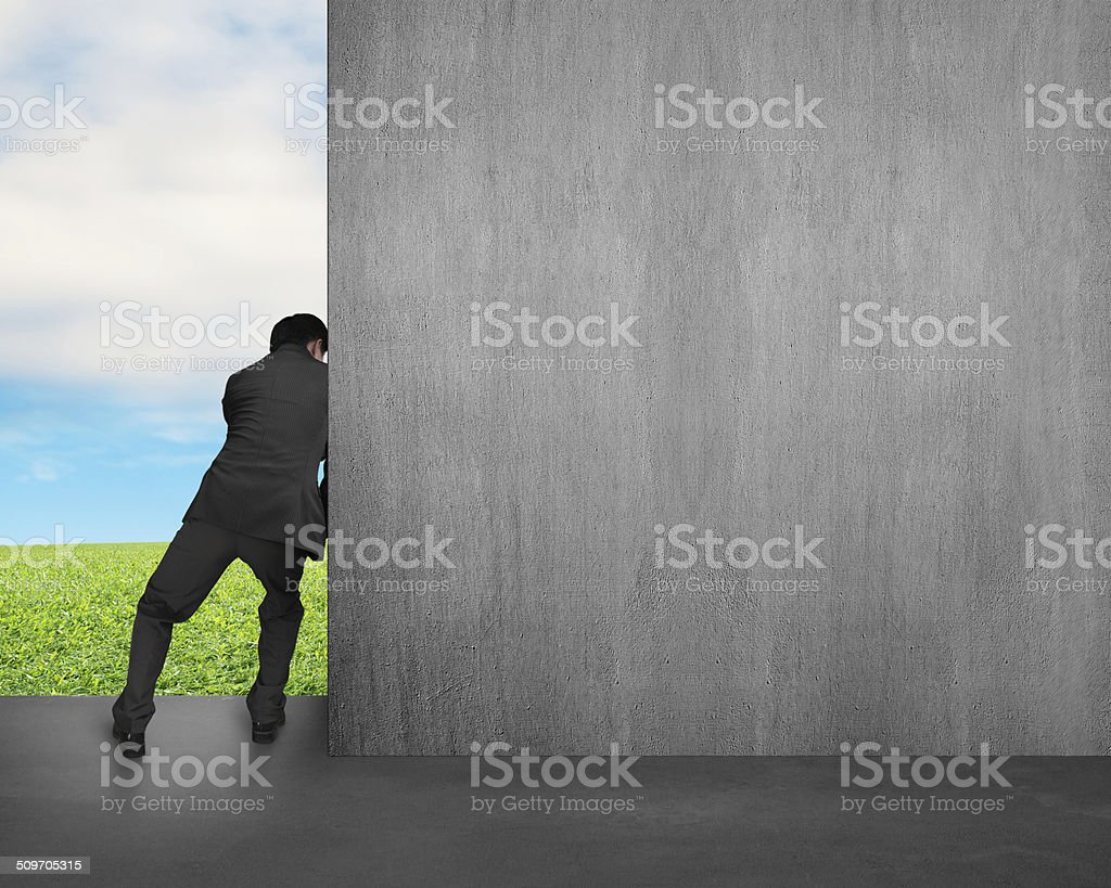 man push away concrete wall stock photo