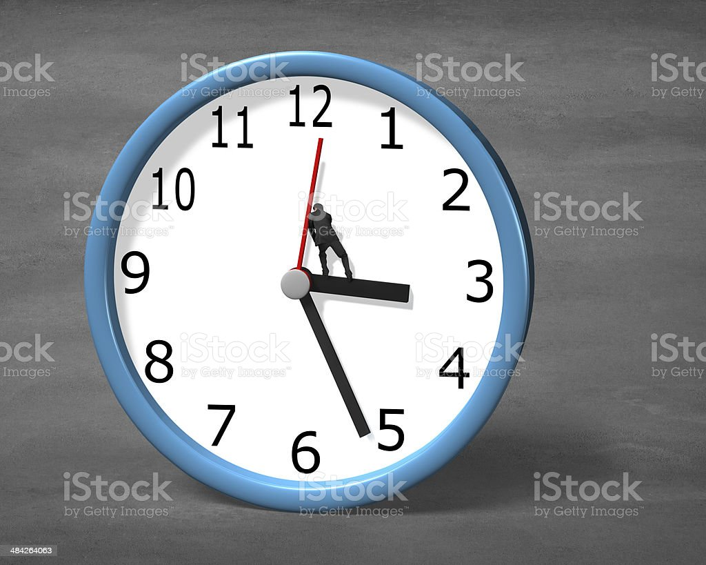 Man pushing clock hand stock photo