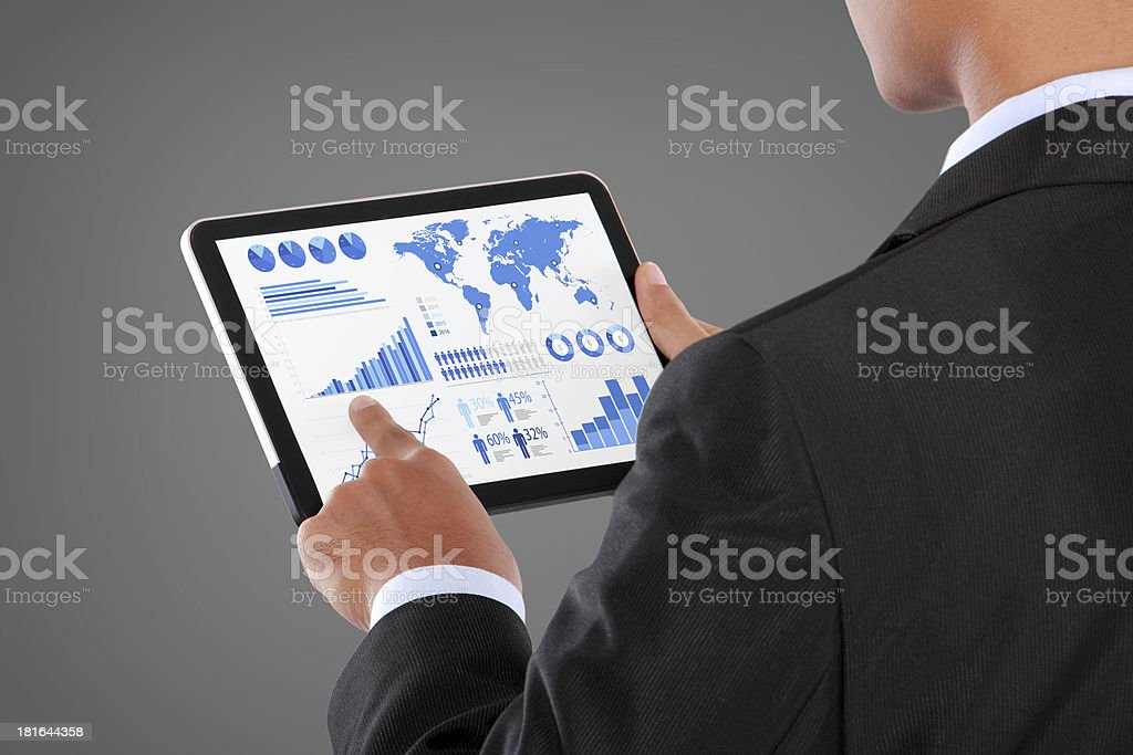 man pushing on a touch screen tablet of infographics royalty-free stock photo