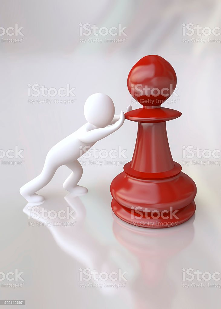 Man Pushing the Chess Pawn Piece stock photo