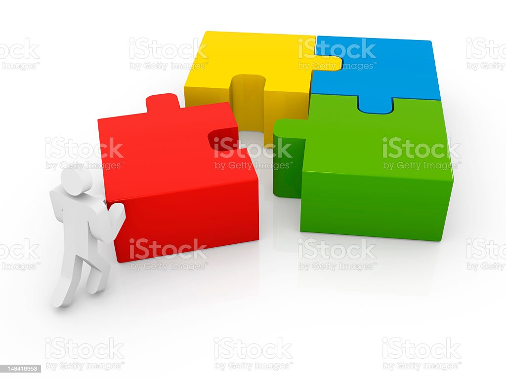 Man pushing the final piece into a jigsaw puzzle royalty-free stock photo