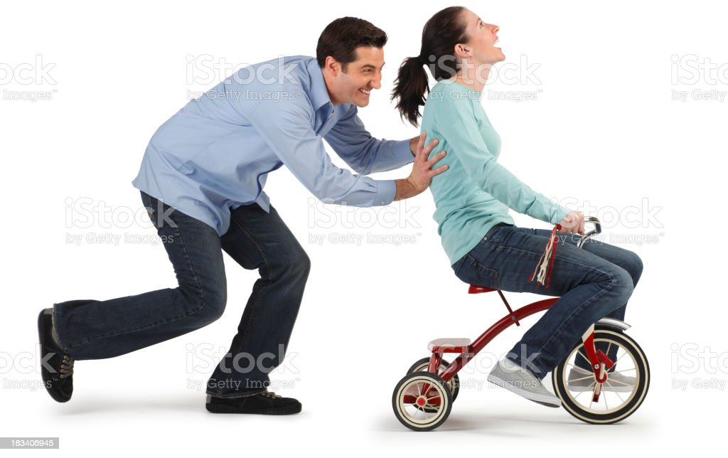 Man Pushing Woman on Tricycle royalty-free stock photo