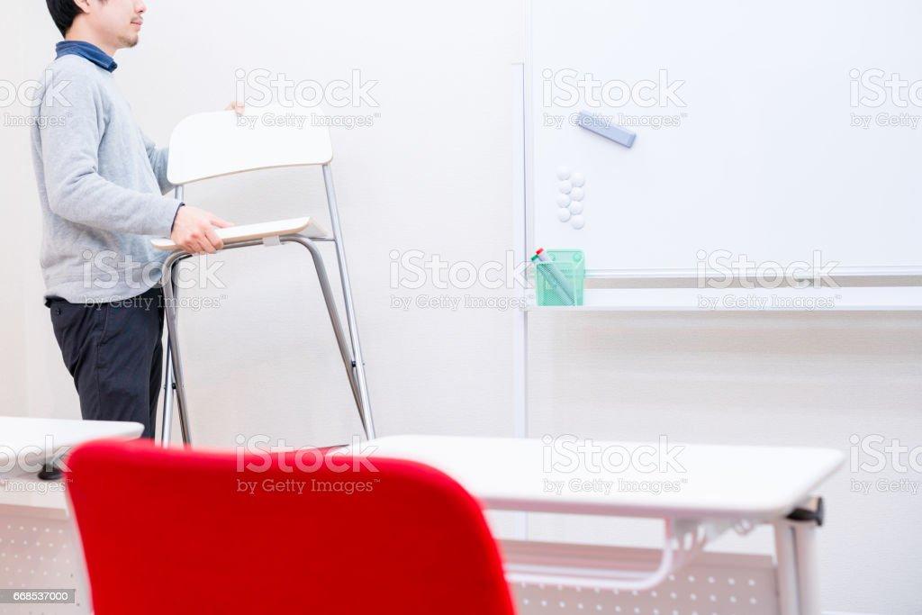 Man put chair away stock photo