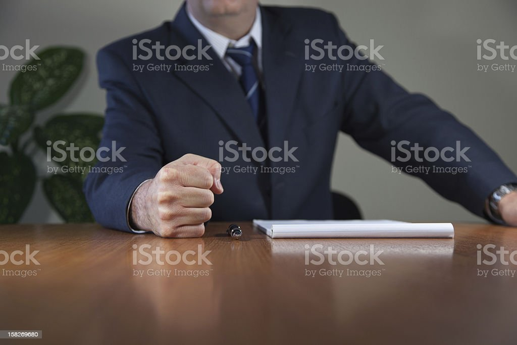 Man Put Fist on the Table stock photo
