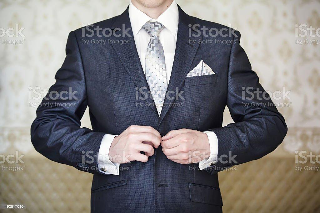 Man puts on jacket. stock photo