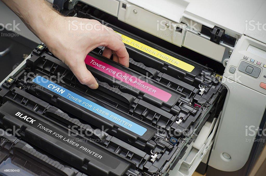 Man puts toner in the printer stock photo