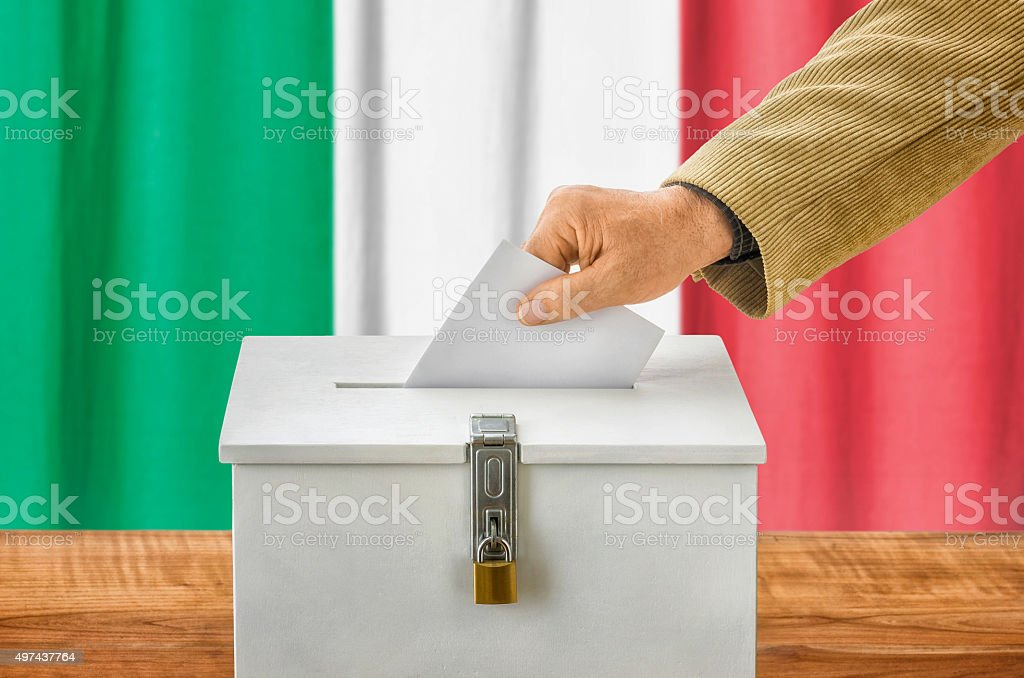 Man putting a ballot into a voting box - Italy stock photo