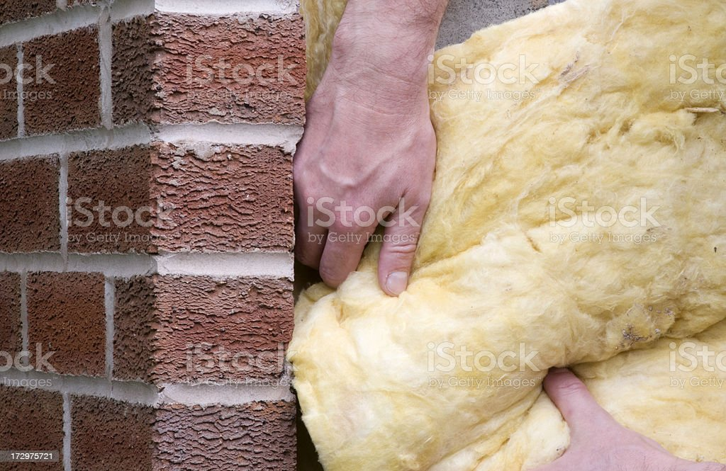 Man putting insulation into a property stock photo